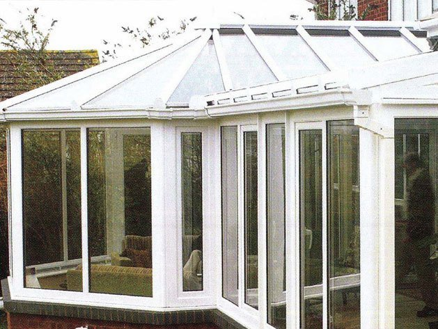 Conservatory in white with doors open