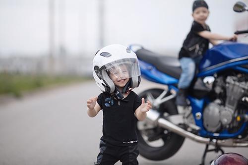 Children enjoying an insured motorcycle in New London, CT