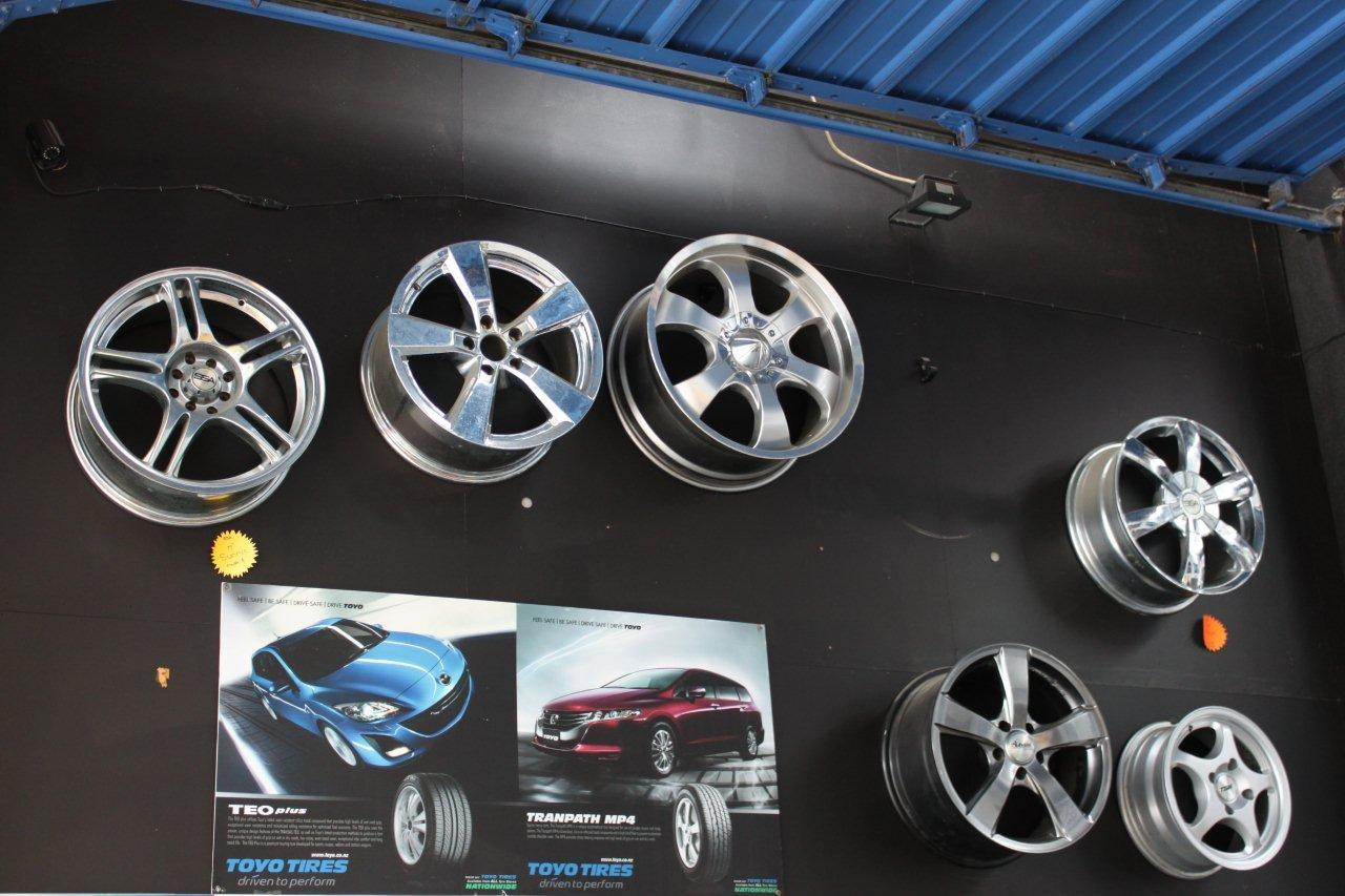alloy wheels mounted on wall