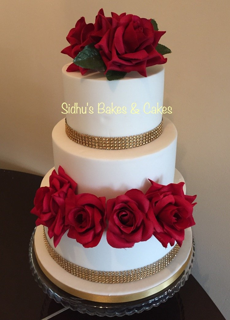 wedding cake with edible red roses