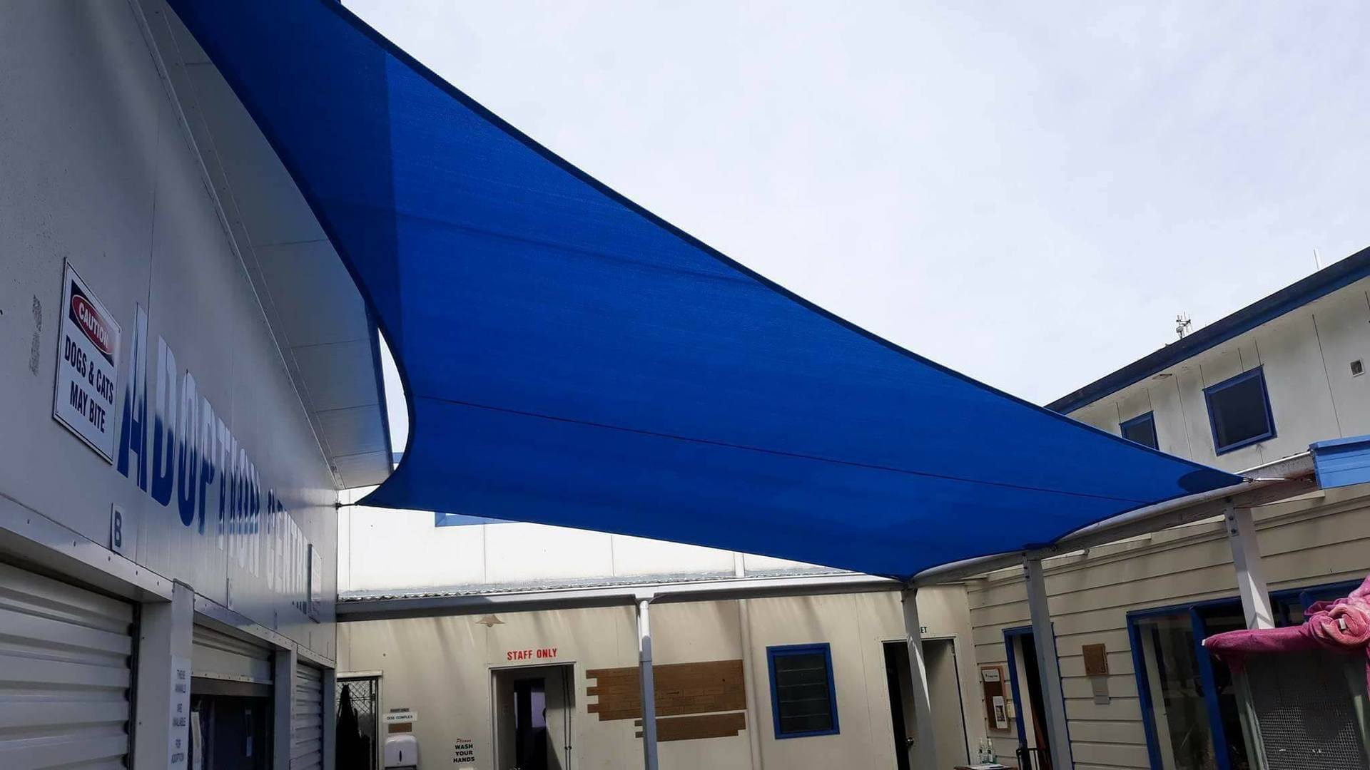 A home in Nelson with shade sail, clear screens, covers, shade solution
