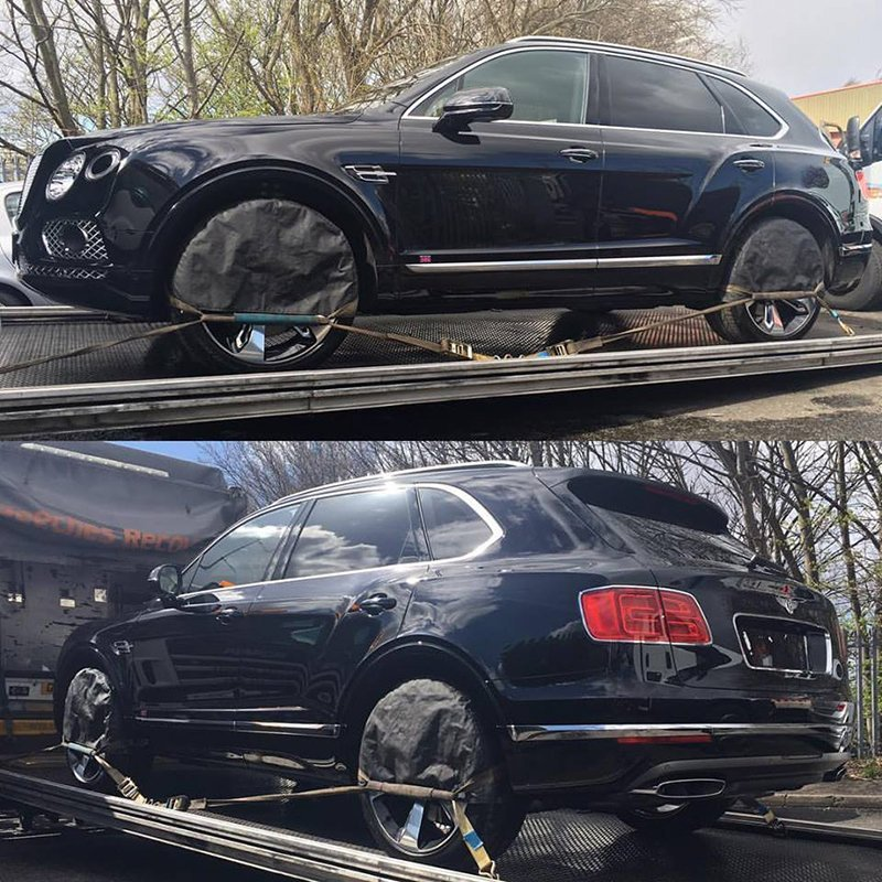 side view of the black car