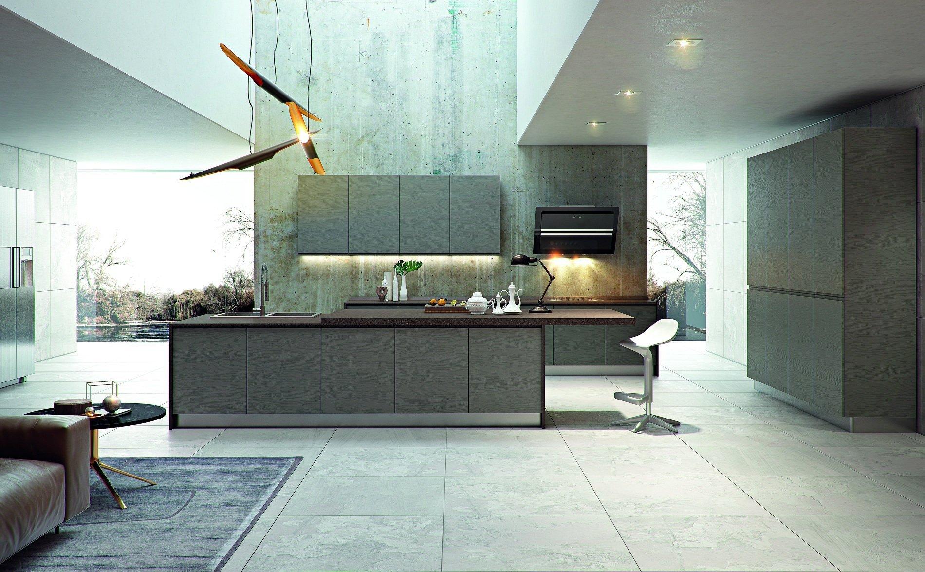 una cucina moderna con penisola e dei lampadari moderni a sospensione
