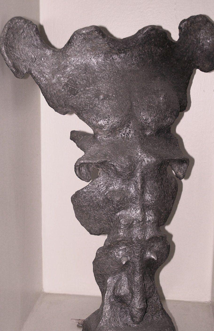 scultura in terracotta patinata