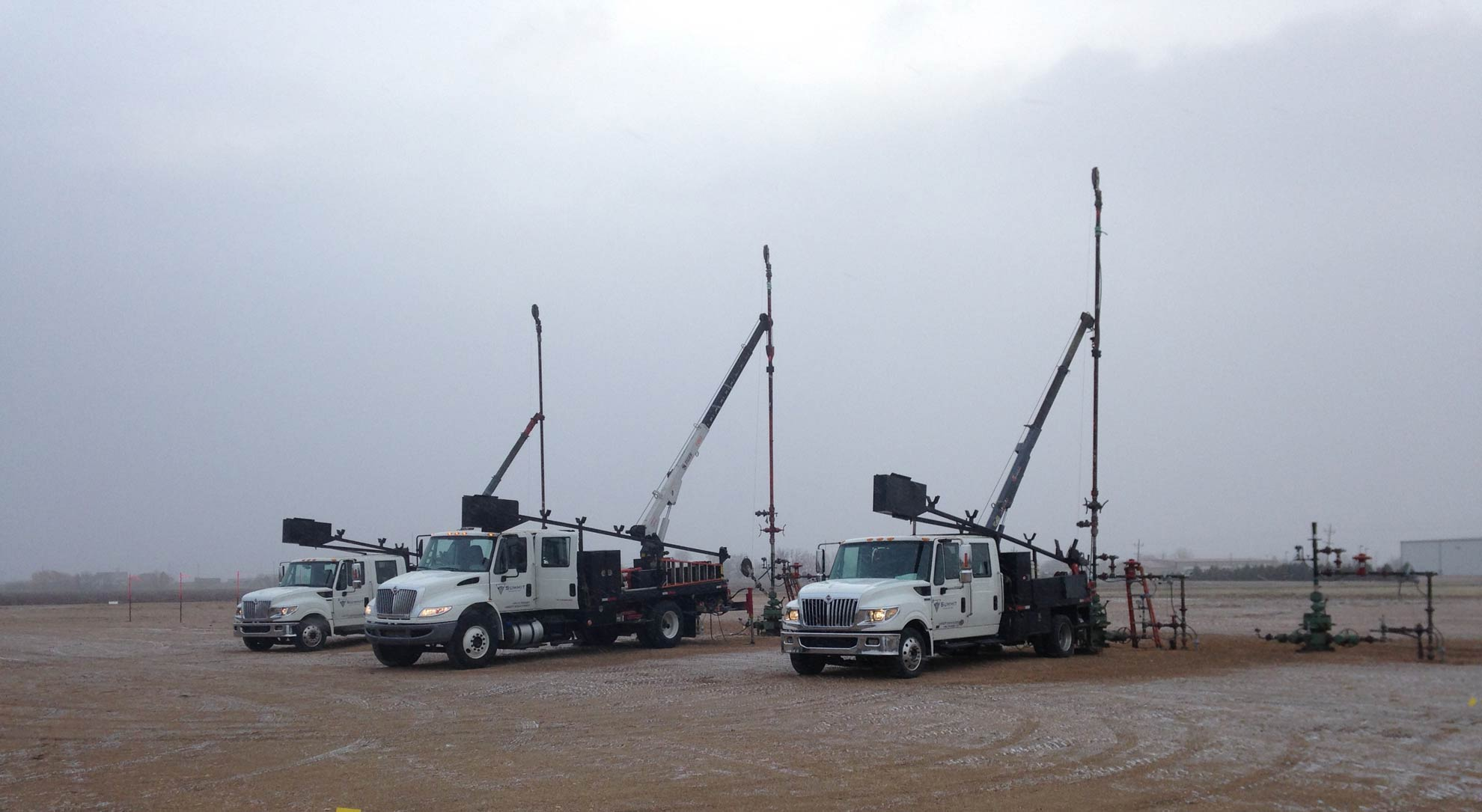 Trucks in process of well drilling in Greeley, CO