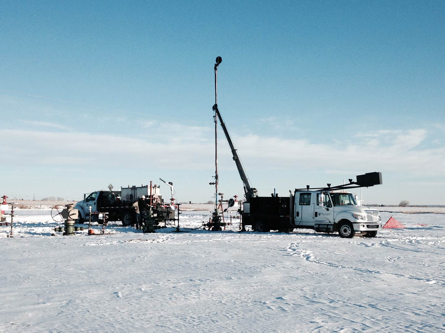 Truck in process of well drilling regardless of winter weather in Greeley, CO