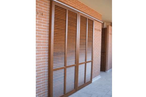 porta persiana scorrevole finitura legno