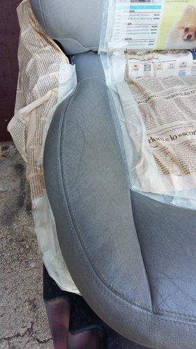 sedile coperto da carta di giornale