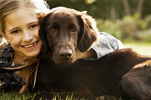 Redlynch Valley Vets Small girl smiling with dog