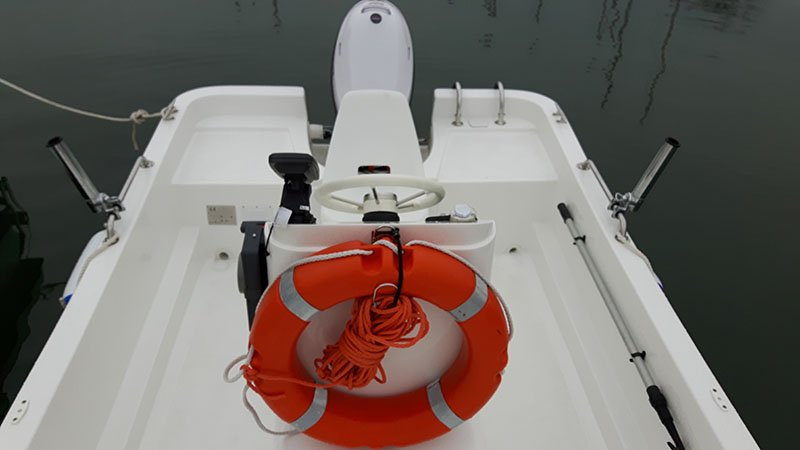 White boat with life preserver