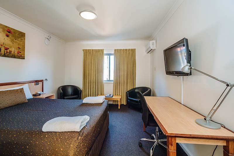 Luxury motel bedroom with desk
