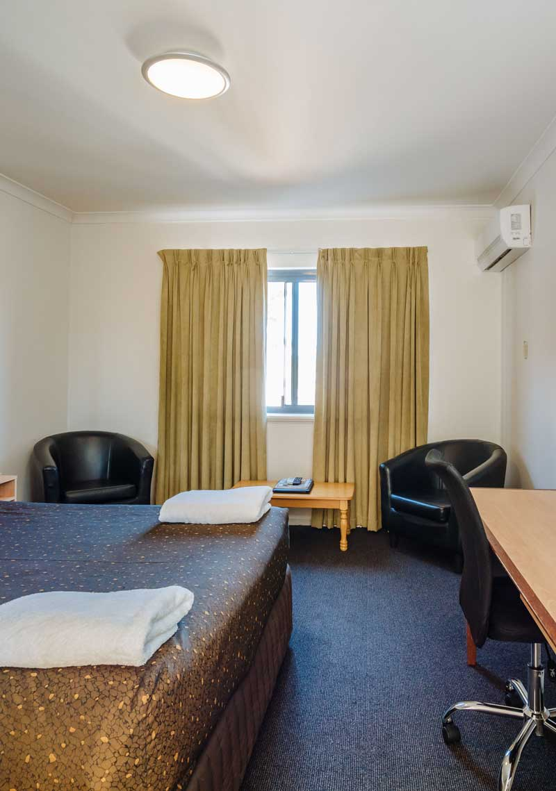 hotel room with two chairs