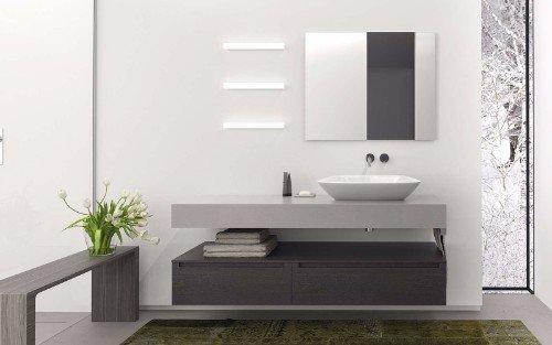un mobile da lavabo di color grigio chiaro e scuro e uno specchio a muro