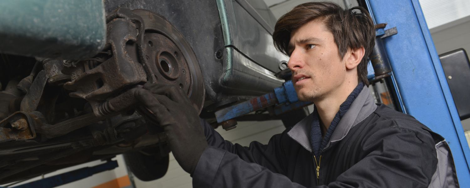 Technician performing an engine repairs service in Hinesville, GA