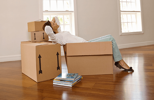 woman relaxing on move house boxes in Sheffield