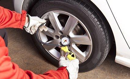 mechanic repairing tyres