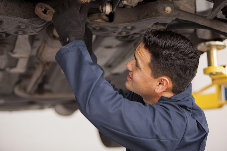 Mechanic works on a car
