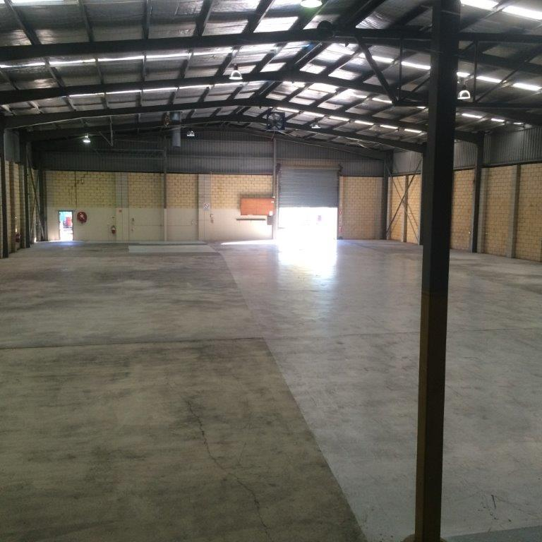 View of the open warehouse after the plumbing work completed