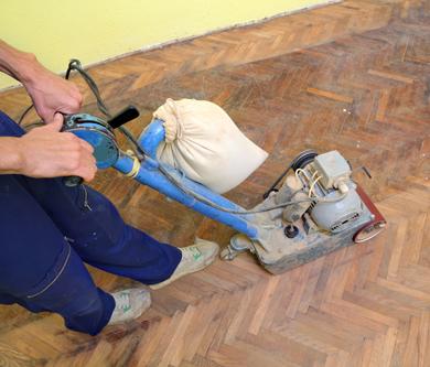 Professional providing floor sand service