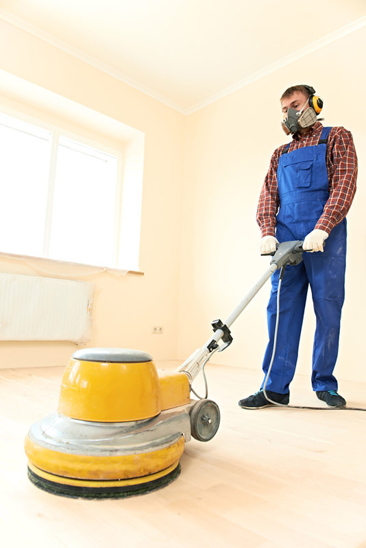 Professional providing expert floor treatment service in Auckland