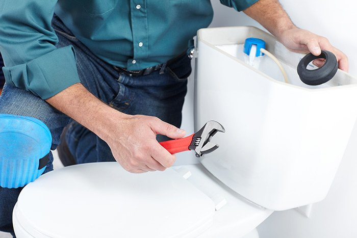 plumber-fixing-blocked-toilet