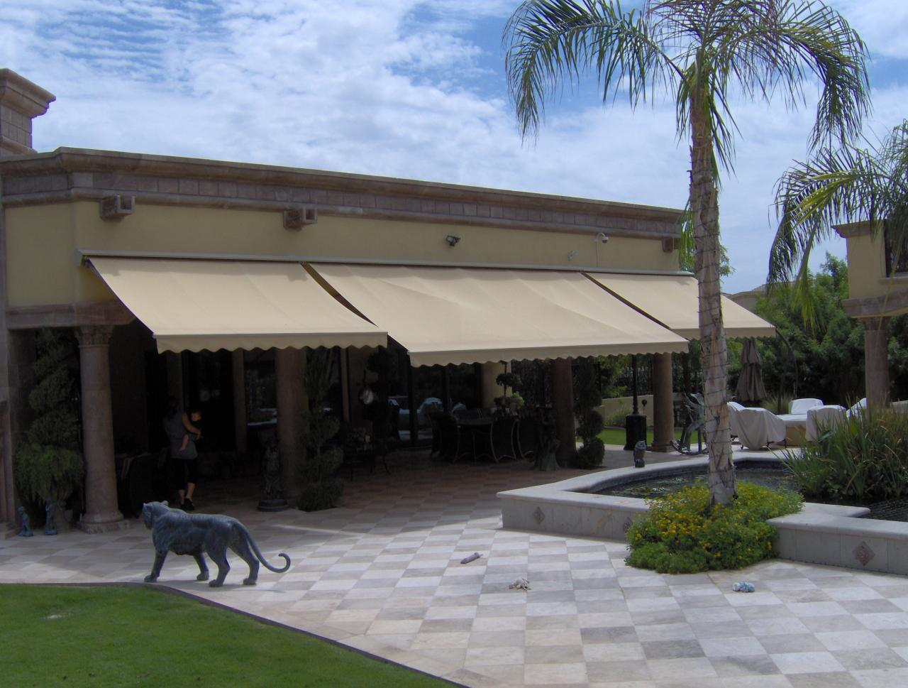Multiple Motorized Retractable Awnings On Custom Home
