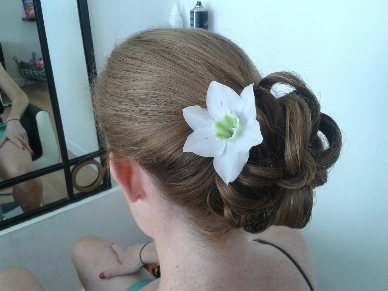 hairstyled with a flower