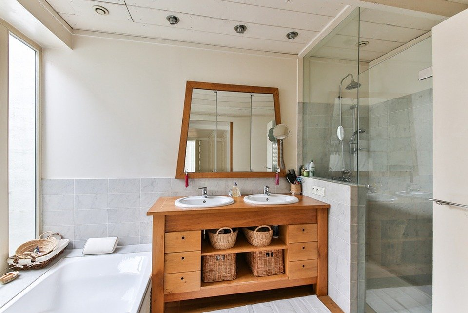 bathroom with two basins and brown cabinets