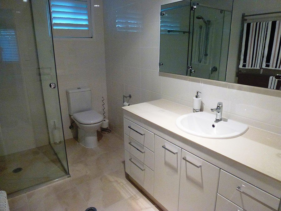 toilet and basin with cabinets under