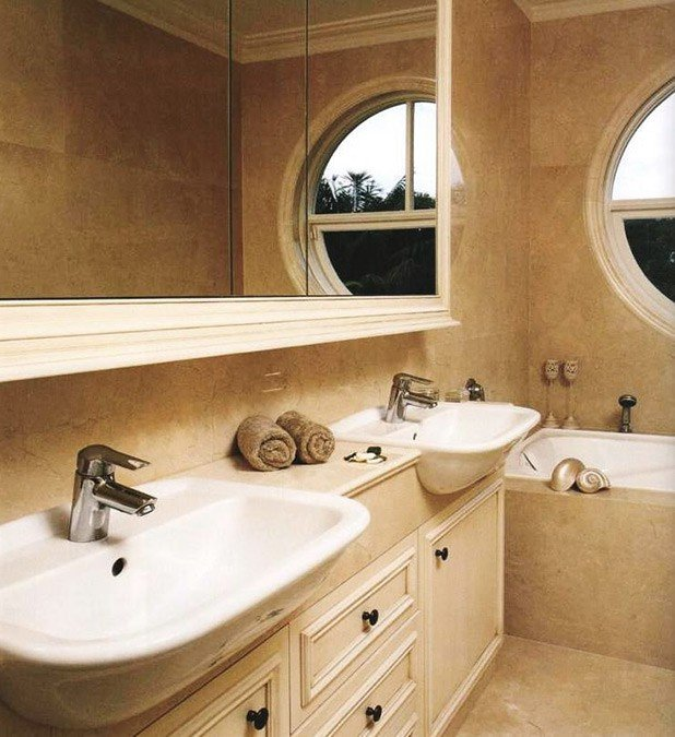 bathroom area with a circle window