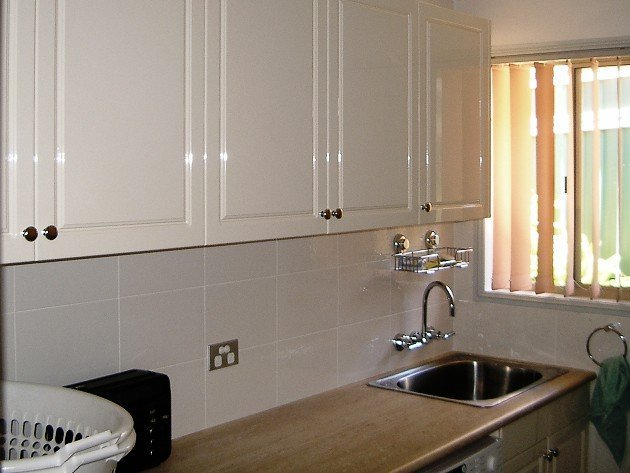sink with white cabinets on top