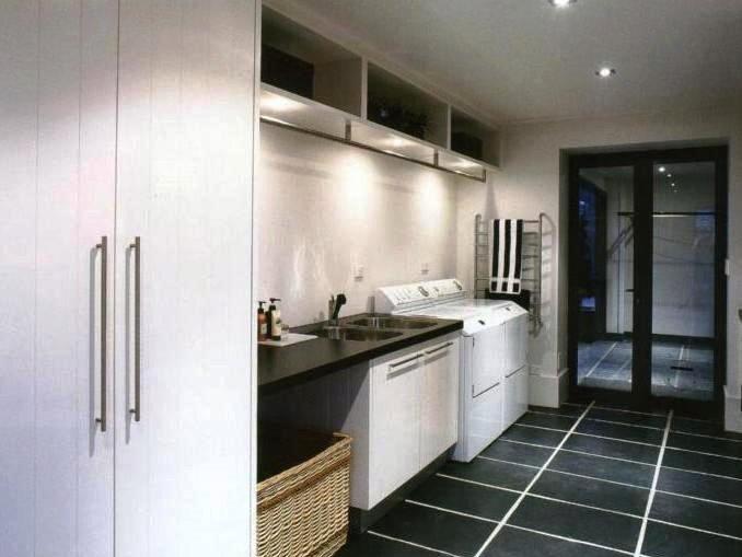 big white cabinet with laundry machine