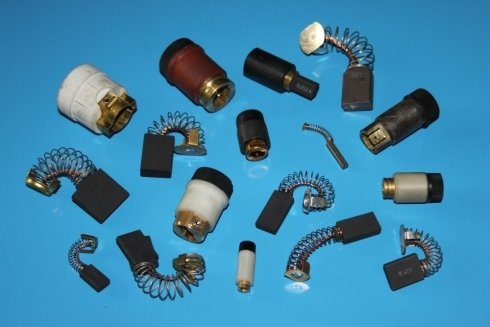 CARBON BRUSH HOLDERS AND CARBON BRUSHES FOR PERMANENT MAGNET MOTORS