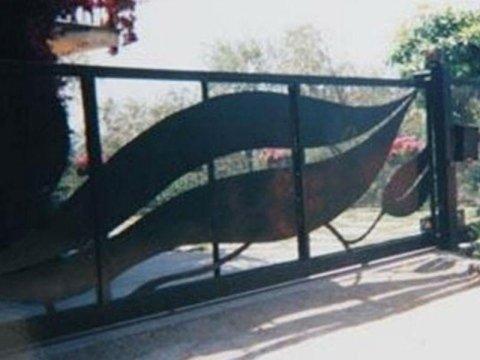 Realizzazione cancelli in ferro fabbro Sirola Rapallo