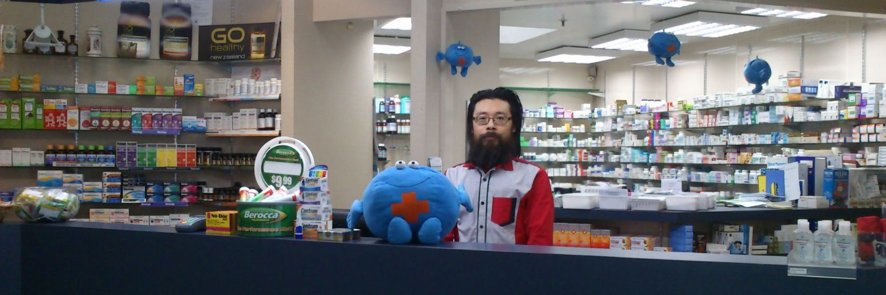 Man behind the counter of Dunedin's trusted pharmacy