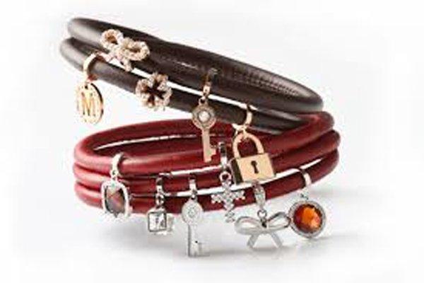 braccialetti cinturini in pelle color marrone e rosso scuro