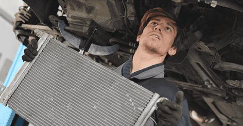 Expert installing the car radiator