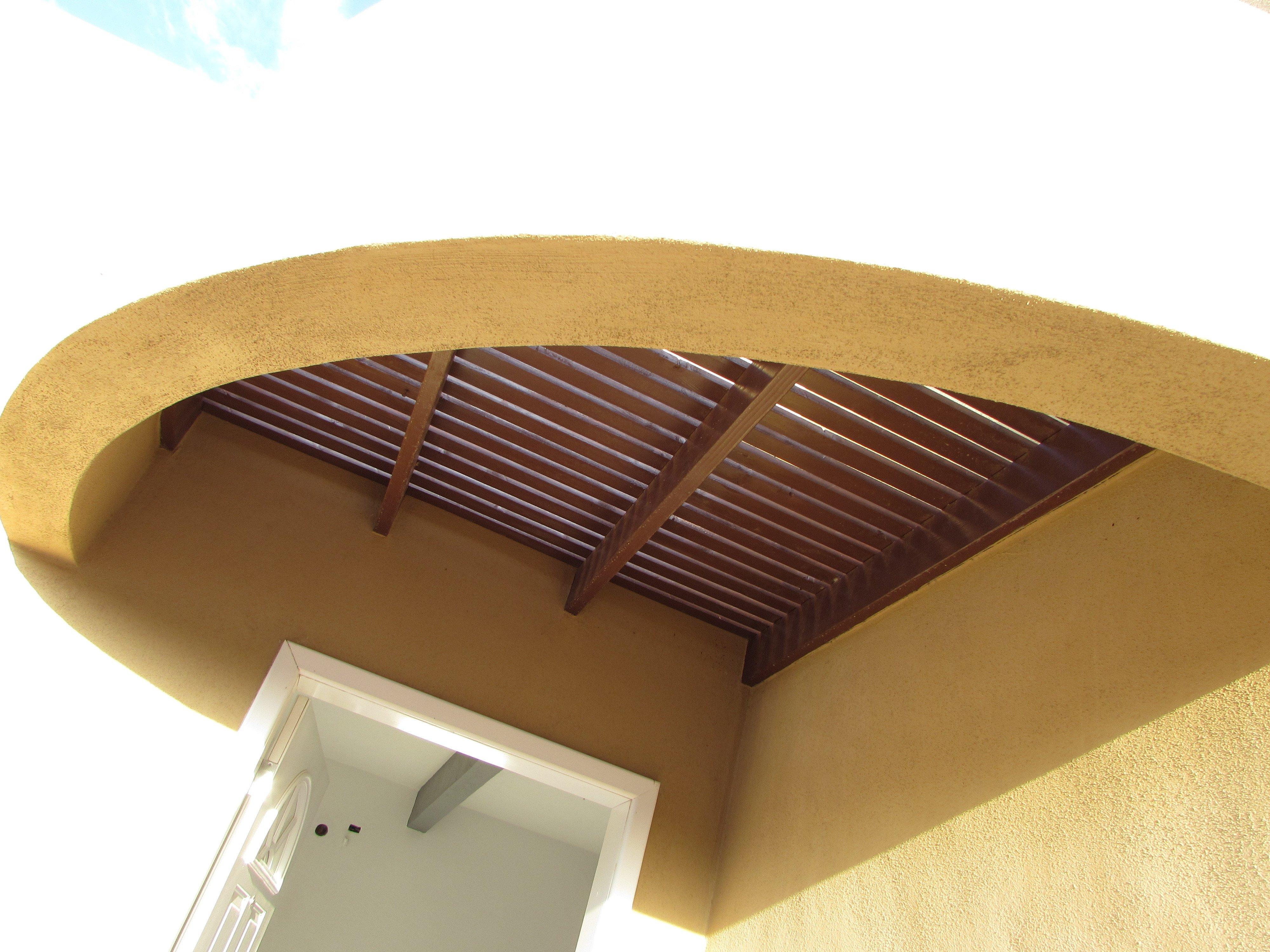Trellis detail above front door