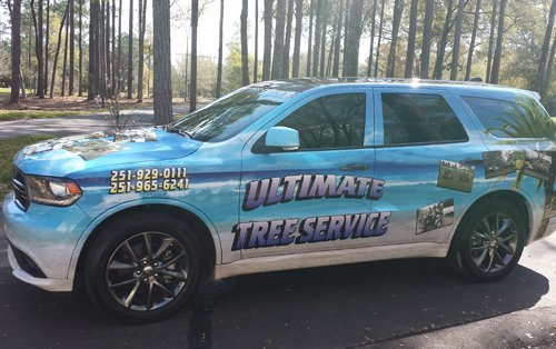 Ultimate Tree Service truck with vehicle wrap