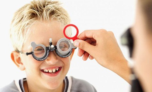 Child undergoing an eye exam in Catoosa County, GA