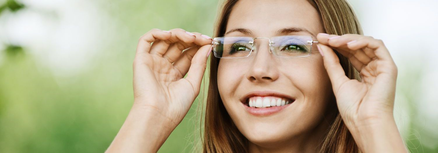 Woman enjoying a good sight thanks to prescription glasses in