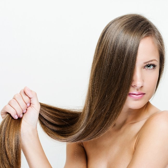 A female model holding her healthy strong hair
