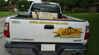 Back of truck showing Advanced Pest Control logo