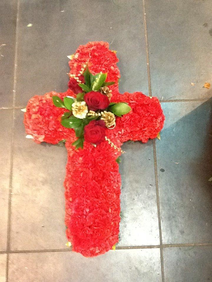 red colour cross shape flower bouquet