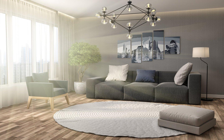 divano tre posti con poltrona tappeto e pouf