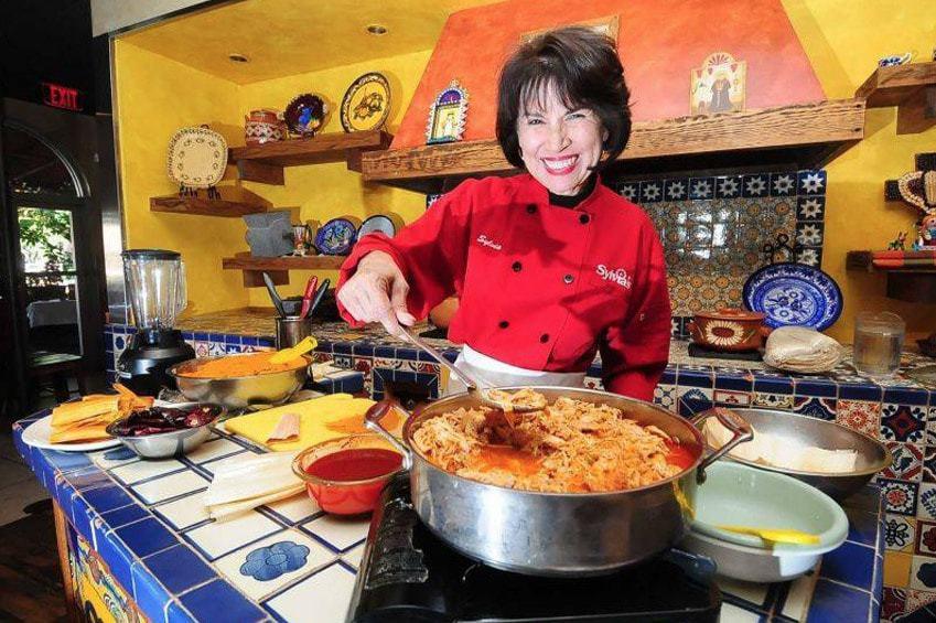 Sylvia teaching how to make enchilada's
