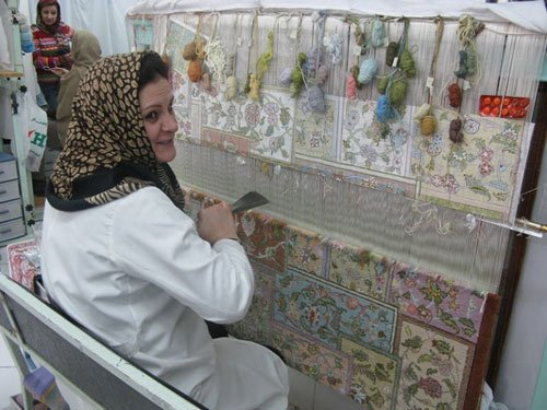 Persian woman weaving the carpet