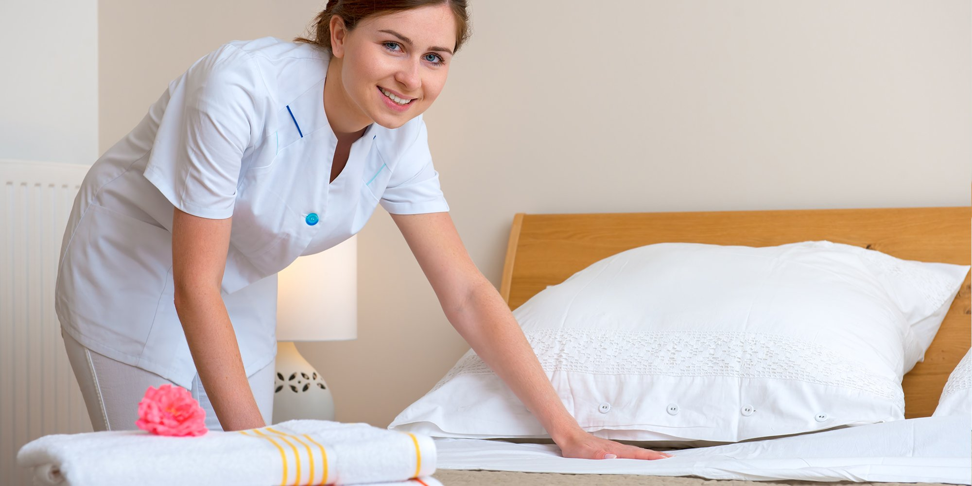 House keeping professional organizing the bed
