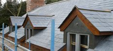 Slate roof with multiple roof windows