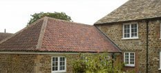 House with tiled roof extension